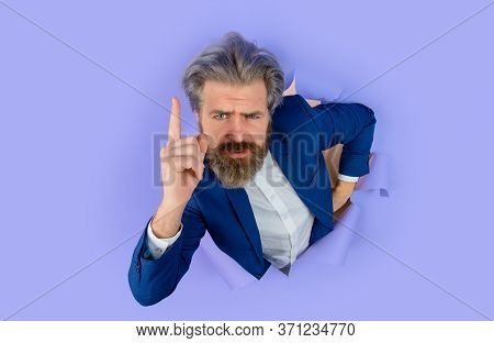 Bearded Man Looking Through Paper. Serious Businessman. Business Growth. Through Paper. Advertising.