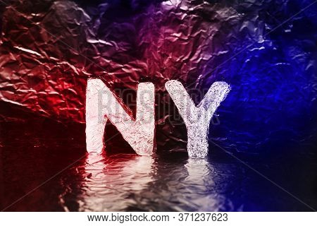 Letters Ny From Foil On A Blue And Red Shiny Background