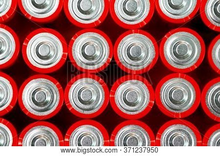 Red Batteries Top View, Alkaline Battery Aa Size Format, Macro. Energy Abstract Background