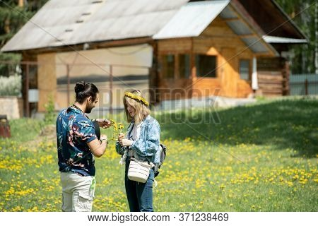 Young man making wrench with girlfriend while they spending weekend in countryside