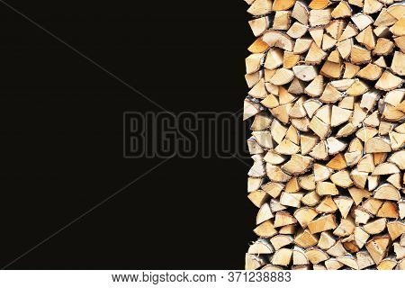 Woodpile Of Birch Firewood Isolated On Black Background