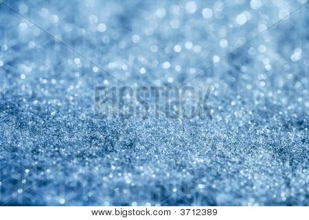 Blue Glitter Sparkles Background With Star Light