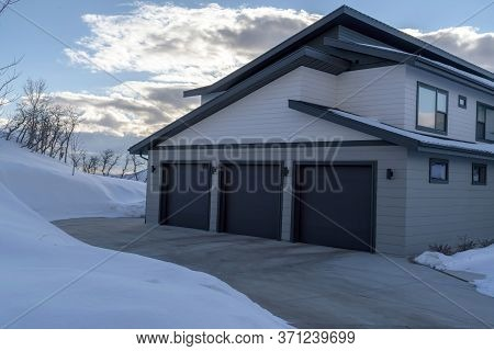 Garage Entrance Of A Home On The Scenic Snowy Terrain Of Wasatch Mountains