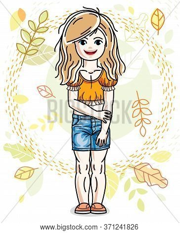 Sweet Little Blonde Girl Standing On Background Of Autumn Landscape And Wearing Stylish Casual Cloth