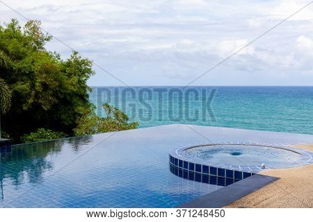 Swimming Pool Overlooking View Andaman Sea And Clear Sky Background,summer Holiday Background Concep