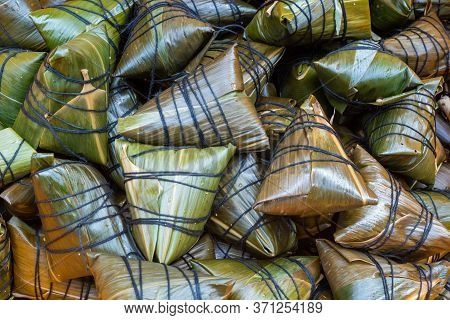 Heap Of Zhongzi - Traditional Chinese Rice Dish Made Of Glutinous Rice Stuffed And Wrapped In Bamboo