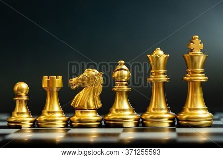 Gold Chess Piece Stand In A Row (king, Queen, Bishop, Knight, Rook, Pawn) On Black Background