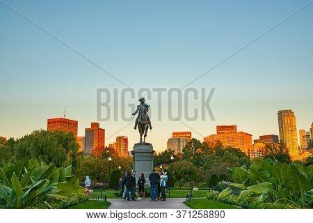 Boston Usa - October 13 2014; City Buildings Catch Late Afternoon Sun Beyond George Washington Monum
