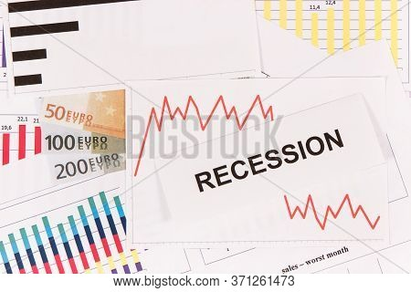 Inscription Recession, Currencies Euro And Downward Graphs Representing Financial Crisis Caused By C
