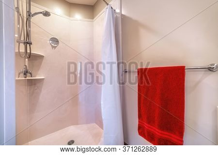 Shower Area With Stainless Steel Shower Head Tile Wall Curtain Mirror And Racks