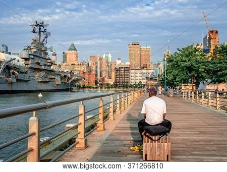 New York City, Ny / Usa - July 13 2014: Rear View Of An Unidentified Man That Sits On A Bench At Pie
