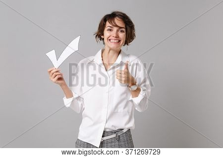 Smiling Young Business Woman In White Shirt Posing Isolated On Grey Background Studio Portrait. Achi