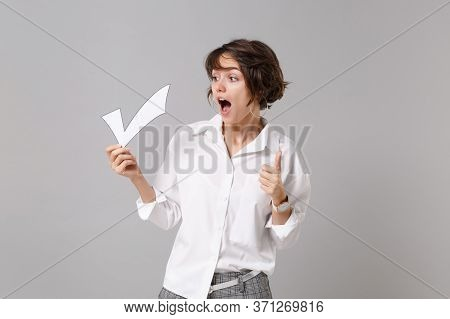 Shocked Young Business Woman In White Shirt Posing Isolated On Grey Background Studio Portrait. Achi