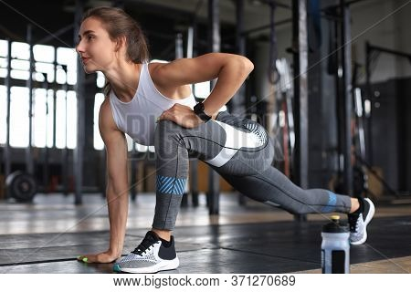 Young Sporty Woman Stretching At The Gym.
