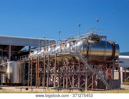 Modern Winemaking Equipment. Wine Factory With Large Tanks For The Fermentation.