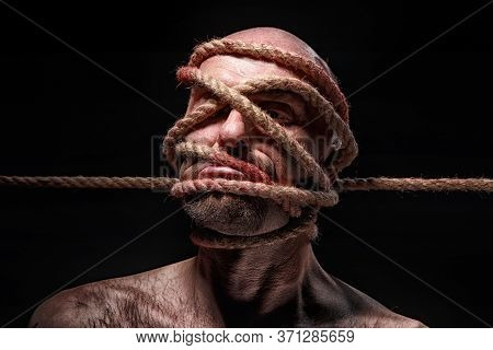 Image Of Binded Bald Man With Rope On Face