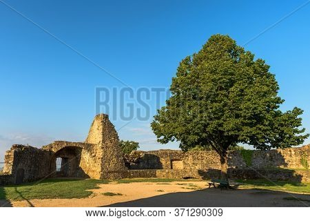 Lindenfels, Odenwald, Hesse, Germany - May 15, 2020. Ruined Castle Yard With Tree And Walls At Castl