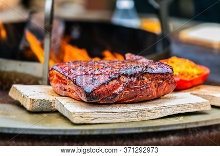 Fresh, Delicious Grilled Meat. Grilling Steak On Bbq. Close Up View Of Grilling Steak