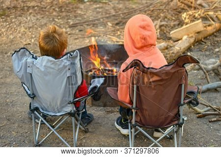 Kids Burning Fire At Kuitpo Forest Camping Ground During Winter School Holidays, South Australia
