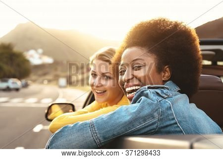 Happy Girls Doing Road Trip In Tropical City - Travel People Having Fun Driving In Trendy Convertibl