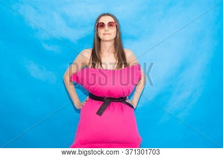 Cute Woman In Pink Pillow Dress Over Blue Background For Crazy Pillow Challenge Due To Stay Home Iso