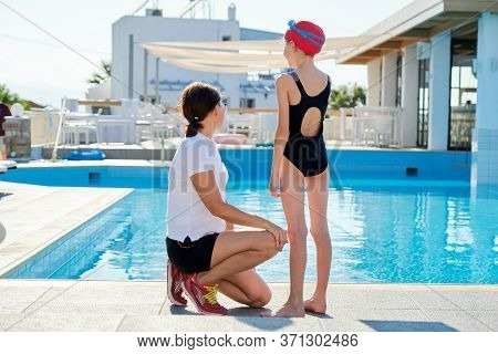 Family, Sport, Swimming, Health, Lifestyle Concept. Portrait Of Mother And Kid Daughter, Back View,