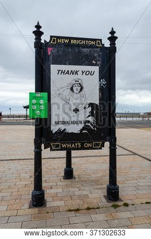 New Brighton, Uk: Jun 3, 2020: A Sign Displays A Torn And Damaged Poster Thanking The National Healt