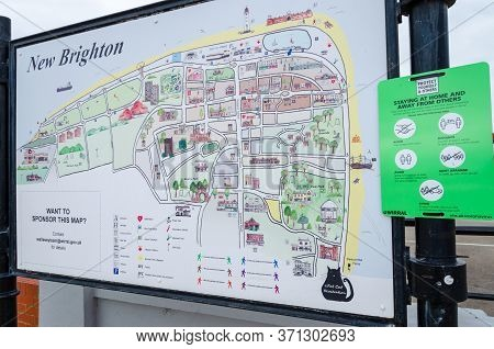 New Brighton, Uk: Jun 3, 2020: A Sign Along Side A Street Map Gives Public Advice About Social Dista