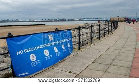 New Brighton, Uk: Jun 3, 2020: A Sign On The Promenade Advises That There Are No Beach Lifeguards On