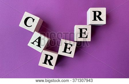 The Word Career On Wooden Cubes On A Purple Background.photo For Business .career Ladder Made Of Cub