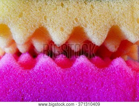 Yellow And Purple Sponges With Serrated Edges For Washing