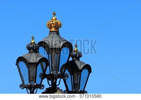 Lanterns With Crowns, Blue Sky. Street Old Wrought Iron Lamp, Dresden, Germany
