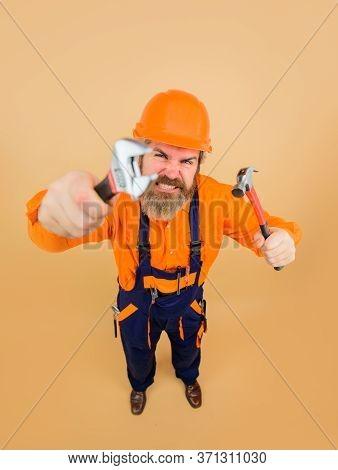 Repair Tools. Building. Industry. Builder With Repair Tools. Bearded Man In Construction Helmet. Wor