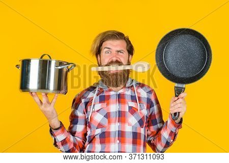 Crazy Chef. Man With Frying Pan And Saucepan. Serious Man Chef With Pot. Saucepan. Cooking. Kitchenw