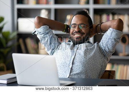 African Guy Put Hands Behind Head Takes Break Watching Movie