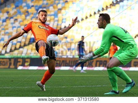 Kyiv, Ukraine - June 6, 2020: Junior Moraes Of Shakhtar Donetsk Fights For A Ball With Goalkeeper Ye