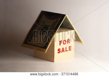 Crisis In The Real Estate Market. House Under A Money Roof, Selling A House, Home For Sale. Mortgage