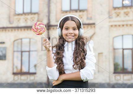Little Girl In Classy Uniform Eat Lollipop. Back To School. Modern Education With New Technology. Ki