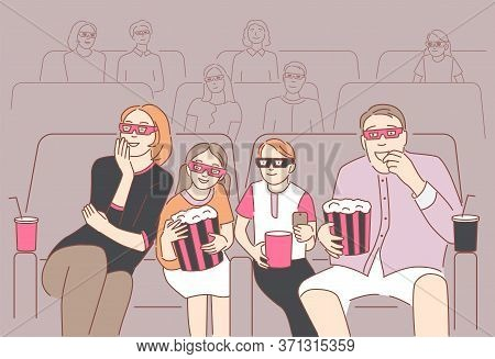 Happy Family Sitting At Cinema Or Movie Theater. Parents With Children Watching 3d Movie Or Cartoon