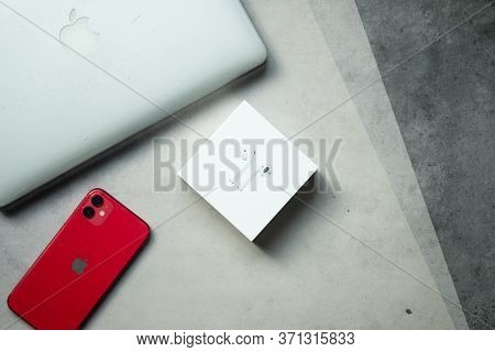 Samut Prakan, Thailand - June 14, 2020 : Apple Iphone 11 Product Red With Airpods And Computer Mac P