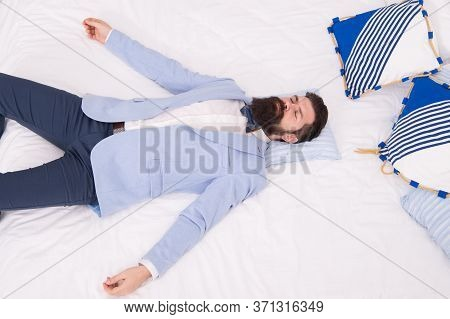 One More Long Day Ended. Feel Tired And Sleepy. Sleepy Guy In Formal Clothes Sleep On Bed. Lack Of S