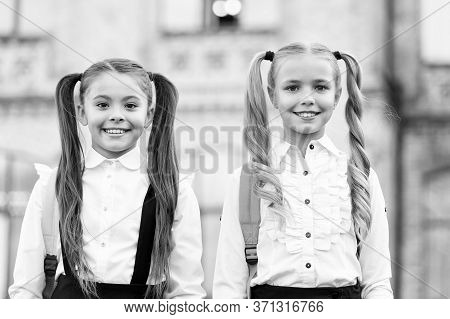 Private School For Girls. School Girls In Pigtails. Happy Girls Back To School. Education And Study.
