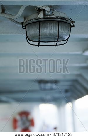 Strong Powerful Light Lamp In A Ferryboat And Ship Holes