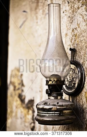 Abstract Vintage Oil Lamp On The Wall