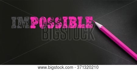 Impossible Word Closeup With Pink Pencil. Impossible Motivation Concept