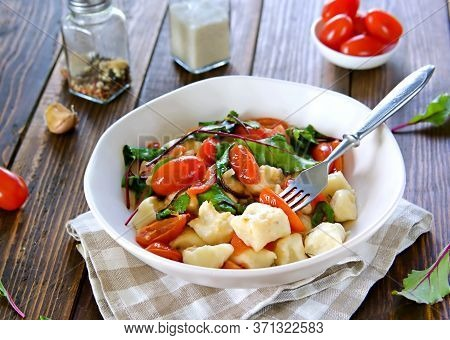 Lazy Dumplings Or Gnocchi From Cottage Cheese With Toppings Of Stewed Tomatoes And Young Beet Tops I