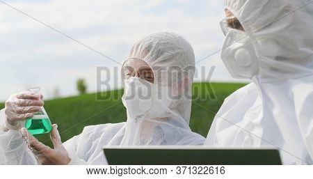 Close Up Of Caucasian Female And Male Farmers Researchers Holding Test Tube With Chemicals Pesticide