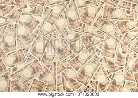 10,000 Yen Banknotes - Background With Several Banknotes Of Ten Thousand Yen Banknotes (front). Japa