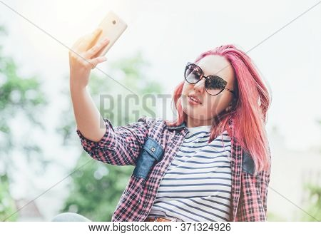 Beautiful Modern Smiling Young Female Teenager With Extraordinary Hairstyle Color In A Checkered Shi