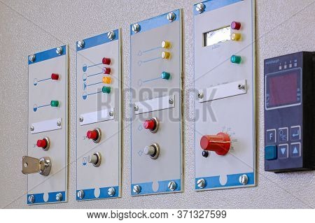 Switches On An Industrial Control Board. Lamp Indicator And Switch Of Power Control Panel.